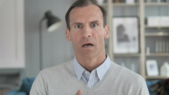 Portrait of Surprised Middle Aged Man, Shocked