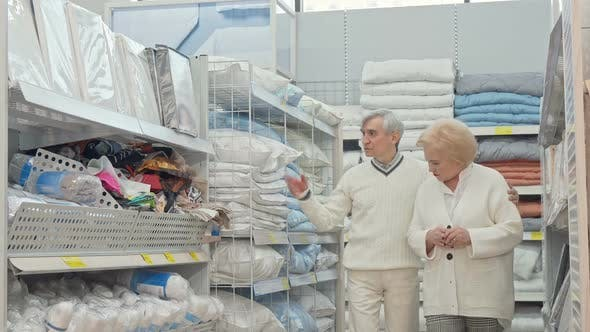 Thumbnail for Happy Retired Senior Couple Walking in Furnishings Store, Shopping for Home Goods