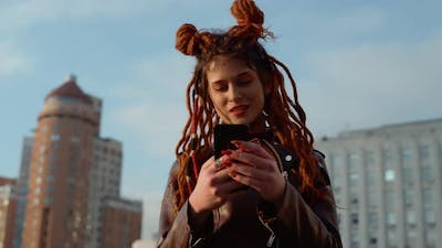 Young Woman Holding Cellphone Outdoor