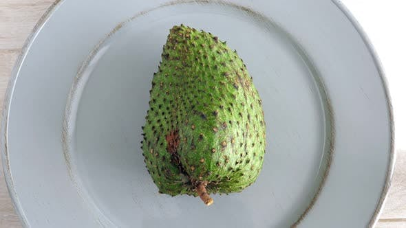 Closeup of Whole Green Soursop Graviola, Exotic, Tropical Fruit Guanabana on Plate