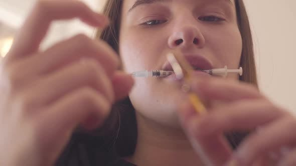 Thumbnail for Young Bad Looking Woman Preparing the Syringe for Injection
