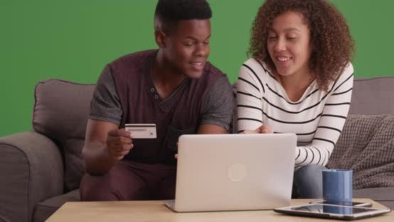 Thumbnail for African American man and woman shop online on green screen.