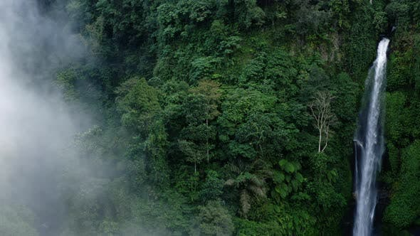 Thumbnail for Moving Through Mist to Reveal a Large Waterfall