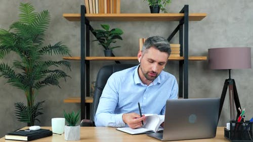 Businessman makes remote online video call conference webcam meeting chat with company employees