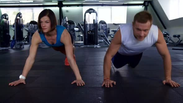 Thumbnail for Fitness Man and Woman Do Push Ups at the Gym