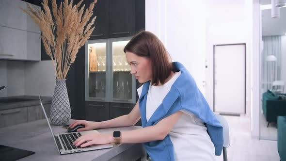 Thumbnail for Young Woman Gamer Playing Online Professional Game on Laptop at Home. Professional Player Testing