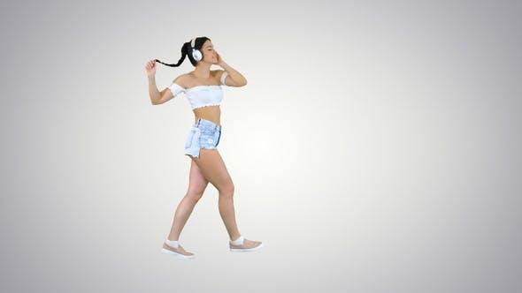 Thumbnail for Latin woman with black hair enjoying music in headphones