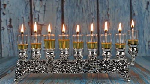 Olive oil candles with orthodox jewish light a hanukkah menorah