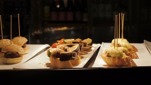 Showcase Window Display Assortiment with Tapas – Traditional Spanish Sandwiches in a Cafe in
