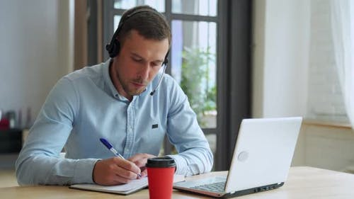 Young Man Student Study at Home Using Laptop and Learning Online