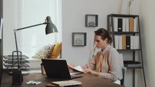 Businesswoman Working in Office and Cooperating with Senior Colleague