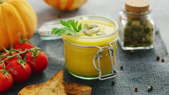Thumbnail for Creamy Pumpkin Soup in Jar with Bread and Tomatoes