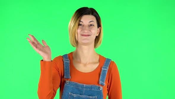 Thumbnail for Woman Waving Hand in the Studio. Green Screen