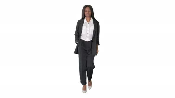 Thumbnail for Casual African American Businesswoman Walking on White Background