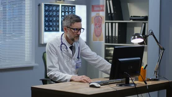 Male Doctor Speaking on Video Call