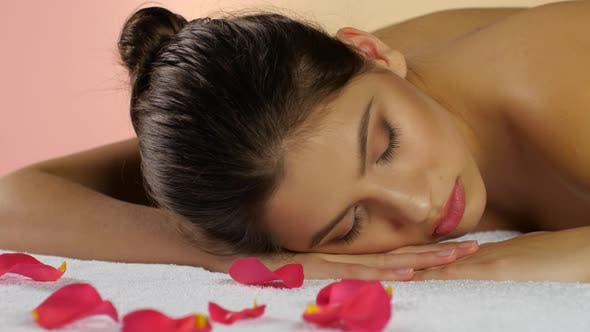 Thumbnail for Woman Sleeps and Rest After Spa Treatments on Rose Petals