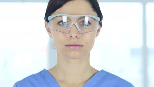 Doctor in Protective Glasses