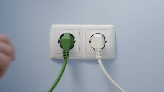 Thumbnail for Hand Plugging Green Power Cord In Socket Concept Eco Green Energy Efficiency Ecology Sustainability
