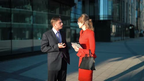 Businessman Rejecting Businesswoman Offer