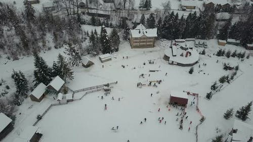 Carpathian Ski Resort From a Height. Flight Over Ski Lifts. Bird's Eye View of People Descending on