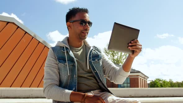 Thumbnail for Man with Tablet Pc Having Video Call on Roof Top