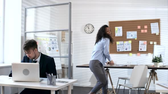 Cover Image for Young Woman Learning Good News and Dancing in Office