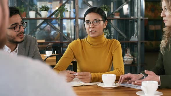 Thumbnail for Multiracial Professionals Discussing Business in Restaurant