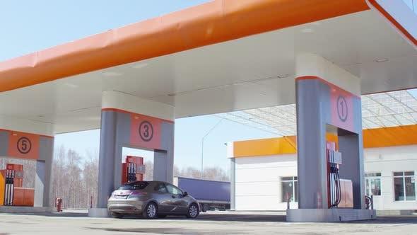 Thumbnail for Car Filling Up at Gas Station
