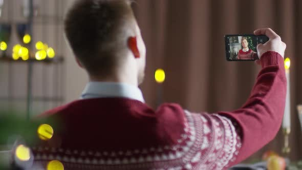 Thumbnail for Young Man in Jumper Taking Selfies at Christmas Party