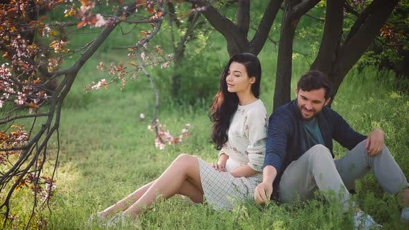 Thumbnail for Young Lovely Couple in Spring Blooming Park Outdoors