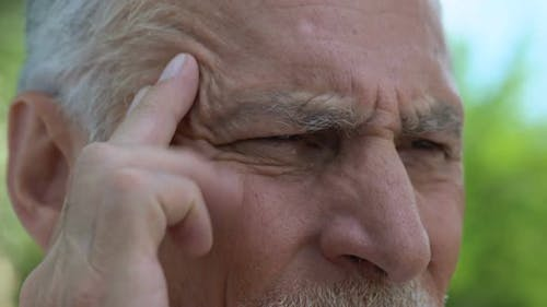 Old Man Massaging Temples Feeling Throbbing Pain, Problems With Blood Pressure
