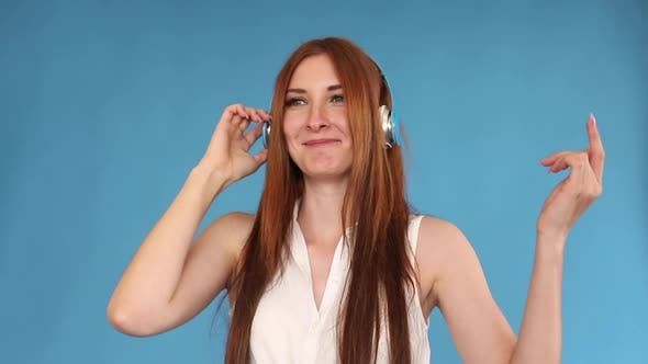 Thumbnail for Jovial Young Woman Dancing While Listening To Music in Headphones