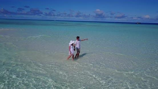 Thumbnail for Beautiful boy and girl on honeymoon vacation enjoy life on beach on white sand