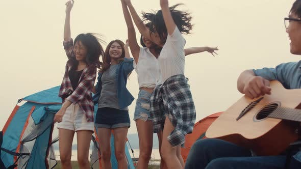 Group of Asia best friends teenagers give high five and dancing enjoy with guitar music happy.