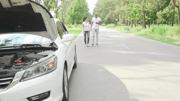 Thumbnail for Couple Waiting for Tow Truck Service on Countryside Road