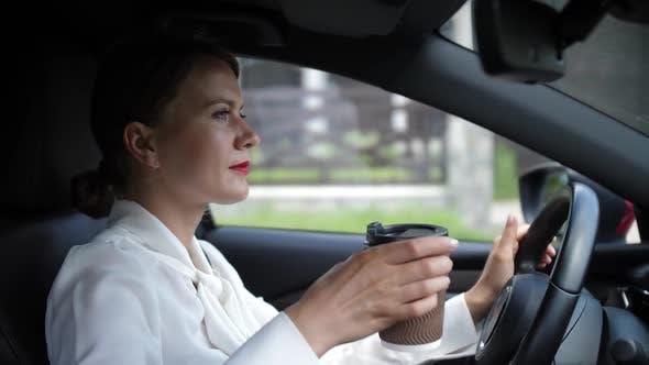 Thumbnail for Pretty Woman Enjoying Coffee Drink Driving Car