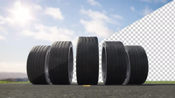 Loop car tires rolling on asphalt in the summer