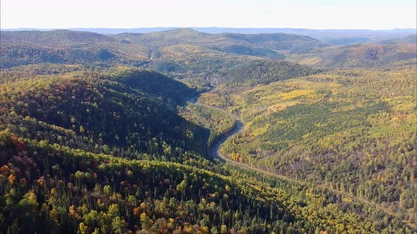 View of the Beautiful Mountain Scenery, Mountain River with a Drone View From Mount Aiger Russia