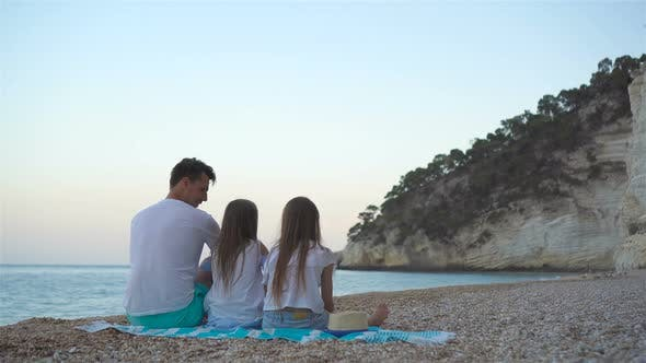 Thumbnail for Father and Two Daughters on the Beach