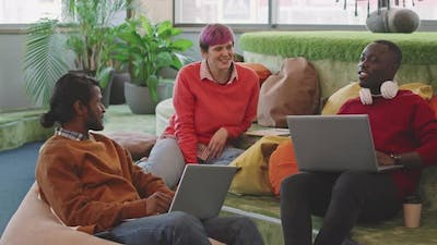 Young People Chatting in Lounge of Start-Up Office
