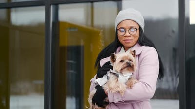 Woman Walking Cute Dog Outdoors on Winter Day