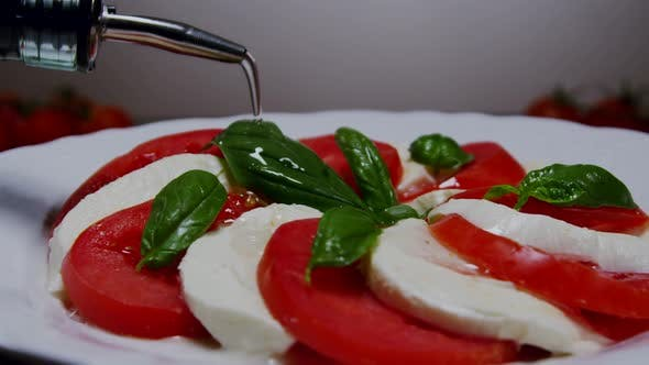 Thumbnail for Pouring Olive Oil Over Caprese Salad 32