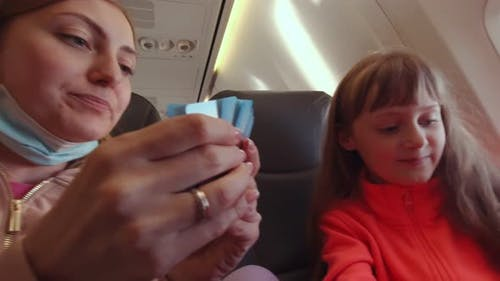 Family Playing Cards In The Plane