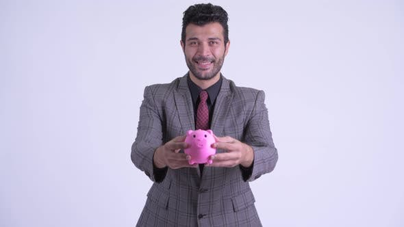 Cover Image for Happy Bearded Persian Businessman Giving Piggy Bank