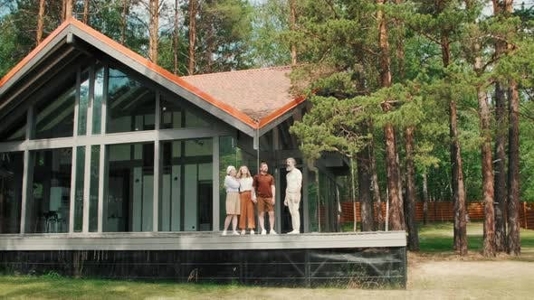 Thumbnail for Elderly People and Young Couple Standing on Porch