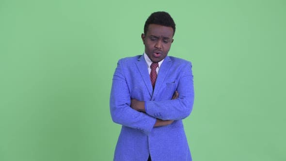 Thumbnail for Stressed Young African Businessman Thinking and Looking Down