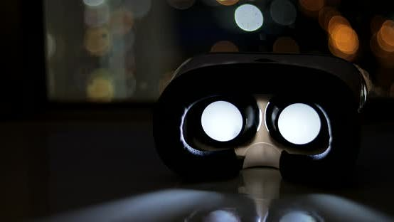 Thumbnail for Virtual reality glasses playing movie at night