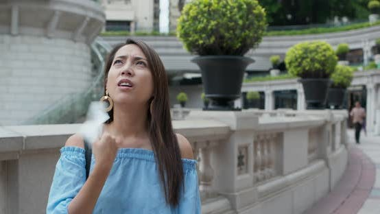 Thumbnail for Woman feel so hot and use of tissue at outdoor