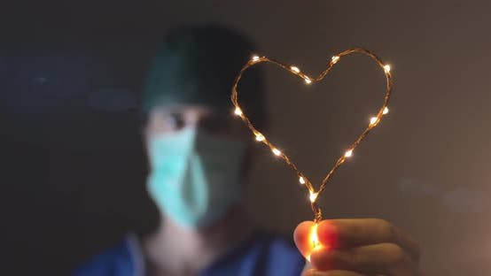 Doctor is Holding an Heart