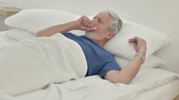 Thumbnail for Coughing Sick Old Man Lying in Bed